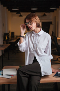 Alluring young businesswoman in glasses