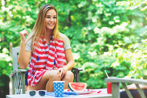 American girl hanging out on the fourth of July in her backyard