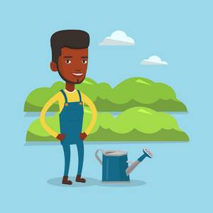 An african-american happy farmer standing near a watering can on the background of agricultural field with green bushes. Man watering plants in garden. Vector flat design illustration. Square layout.