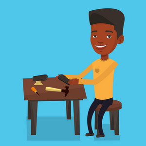 An african-american shoemaker working with a shoe in workshop. Shoemaker repairing a shoe in workshop. Young shoemaker making handmade shoes in workshop. Vector flat design illustration. Square layout