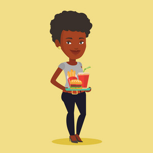 An african-american woman holding tray with fast food. Young smiling woman having a lunch in a fast food restaurant. Happy woman with fast food. Vector flat design illustration. Square layout.