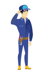 Angry asian mechanic gesturing with his finger against his temple. Full length of young mechanic twisting his finger against temple. Vector flat design illustration isolated on white background.