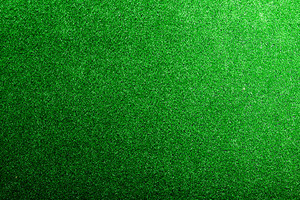 Artificial turf backdrop. Studio shot of green background. Copy space.