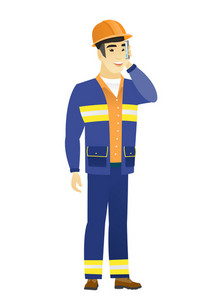 Asian builder in hard hat talking on a mobile phone. Young smiling builder talking on cell phone. Builder using cell phone. Vector flat design illustration isolated on white background.