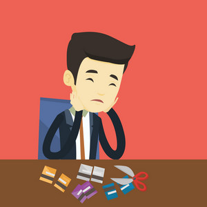 Asian business man cutting plastic card. Upset business man sitting at the desk with cut plastic card. Business man cutting plastic card with scissors. Vector flat design illustration. Square layout.