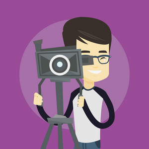 Asian cameraman looking through movie camera on a tripod. Young cameraman with professional video camera. Smiling cameraman taking a video. Vector flat design illustration. Square layout.
