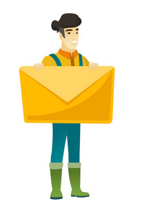 Asian farmer in coveralls holding a big envelope. Full length of farmer holding a big envelope. Cheerful farmer with a big envelope. Vector flat design illustration isolated on white background.