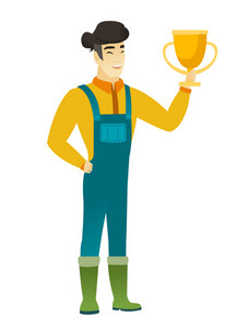 Asian farmer in coveralls holding a golden trophy. Full length of young cheerful farmer with trophy. Happy farmer celebrating with trophy. Vector flat design illustration isolated on white background.