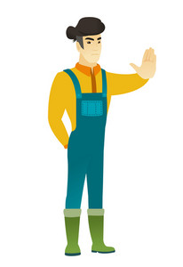 Asian farmer in coveralls showing stop hand gesture. Full length of young farmer doing stop gesture. Serious farmer with a stop gesture. Vector flat design illustration isolated on white background.