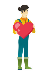 Asian farmer showing a big red heart. Full length of young farmer with heart shape. Happy farmer in coveralls holding a big red heart. Vector flat design illustration isolated on white background.