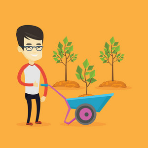 Asian gardener with wheelbarrow standing on the background of newly planted trees. Young gardener pushing wheelbarrow with tree and dirt in the park. Vector flat design illustration. Square layout.