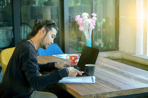 asian man freelance working in home office