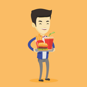 Asian man holding tray with fast food. Young man having a lunch in a fast food restaurant. Happy man with fast food. Unhealthy nutrition concept. Vector flat design illustration. Square layout.