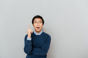 Asian man in glasses. gray background