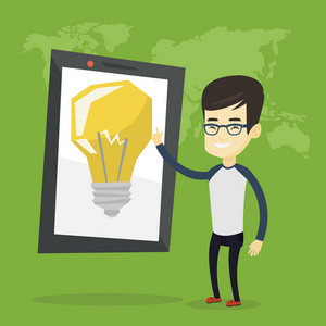 Asian man pointing at a big tablet computer with a light bulb on a screen. Businesman standing near tablet computer on the background with world map. Vector flat design illustration. Square layout.