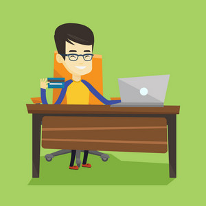 Asian man sitting at the table with laptop and holding credit card in hand. Man using laptop for online shopping. Young man shopping online at home. Vector flat design illustration. Square layout.