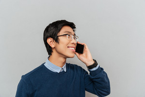 Asian man talking on phone. with glasses