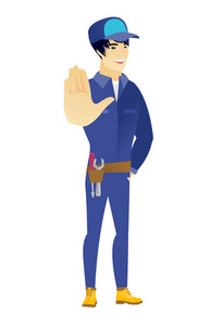 Asian mechanic showing palm hand. Full length of young mechanic showing palm hand. Mechanic making stop gesture by his palm. Vector flat design illustration isolated on white background.
