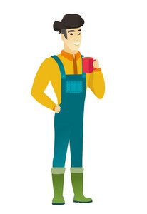 Asian smiling farmer in coveralls holding cup of coffee. Full length of young farmer drinking coffee. Happy farmer with cup of coffee. Vector flat design illustration isolated on white background.