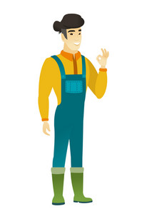 Asian smiling farmer in coveralls showing ok sign. Young cheerful farmer making ok sign. Successful happy farmer gesturing ok sign. Vector flat design illustration isolated on white background.