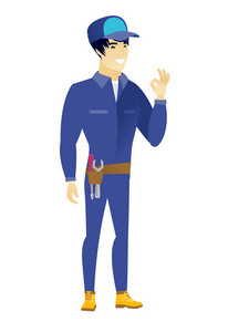 Asian smiling mechanic showing ok sign. Young cheerful mechanic making ok sign. Successful happy mechanic gesturing ok sign. Vector flat design illustration isolated on white background