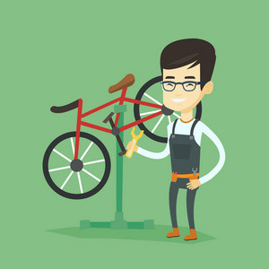 Asian technician working in bike workshop. Technician fixing bicycle in repair shop. Bicycle mechanic repairing bicycle. Man installing spare part bike. Vector flat design illustration. Square layout