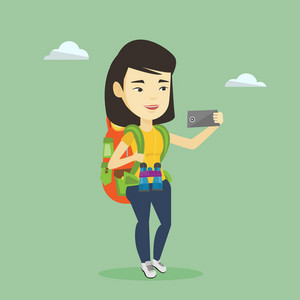 Asian tourist making selfie. Young smiling tourist with backpack taking selfie with cellphone. Female tourist taking selfie during summer trip. Vector flat design illustration. Square layout.