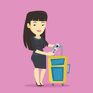 Asian woman holding travel insurance tag. Business class passenger standing near suitcase with priority luggage tag. Business woman showing luggage tag. Vector flat design illustration. Square layout.