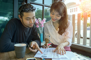 asian younger freelance  start up working at home office