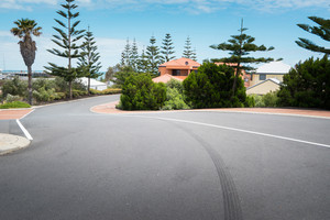 Asphalt road at the little coastal town of Myalup near Bunbury Western Australia .