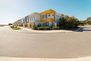 Asphalt road with modern terrace house in front on blue sky background. Yanchep Beach Town , Perth , Western Australia .