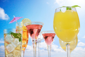 Assortment of drinks over summer blue sky background