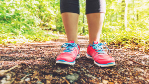 Athletic female runner on a forest trail