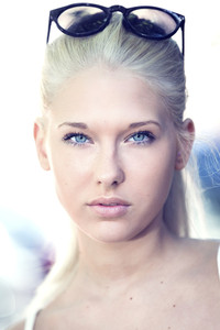 Attractive and cute blonde teen face portrait