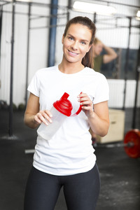 Attractive and smiling woman at the fitness gym
