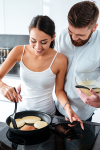 Attractive couple prepared pancake. front view