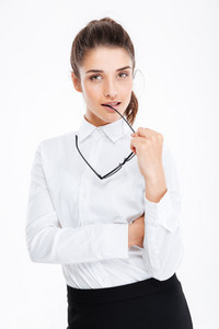 Attractive sensual young businesswoman standing and holding glasses over white background