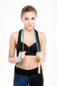 Attractive sport girl holding jumping rope and looking at camera isolated on white background