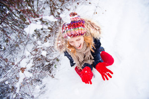 Attractive young woman having fun outside in snow