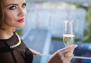 Attractive young woman with a drink on a terrace of a bar