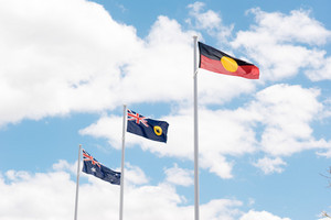 Australian flag flying on a flagpole.