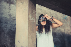 aviator funny young beautiful moroccan curly woman at the park