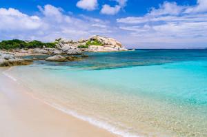 Azure beach with clear water near Porto Pollo on beautiful Sardinia island, Italy