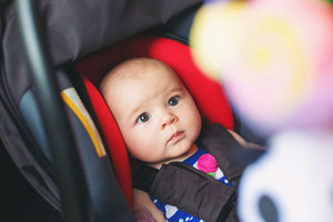 Baby girl buckled into her car seat