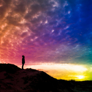 Back light silhouette of a man standing on a hill, overlooking, filtered colorful, square photo - future, power, achievement concept