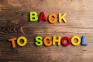 Back to school sign formed from colorful plastic letters.