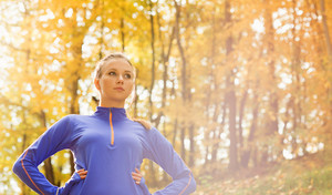 Bautiful running woman jogging in autumn nature