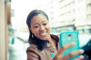 beautiful african young woman selfie in the city