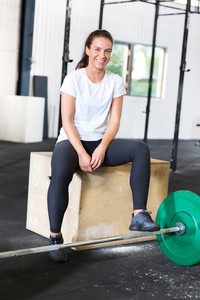 Beautiful and smiling woman at fitness gym center