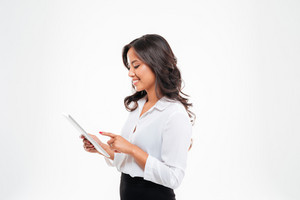 Beautiful asian businesswoman using tablet computer isolated on a white background